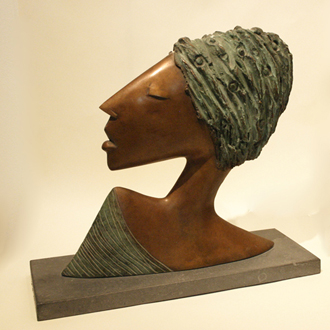 patinated bronze head on limestone base