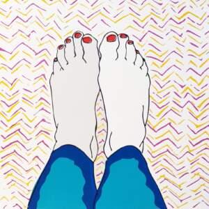 Feet on hospital sheets